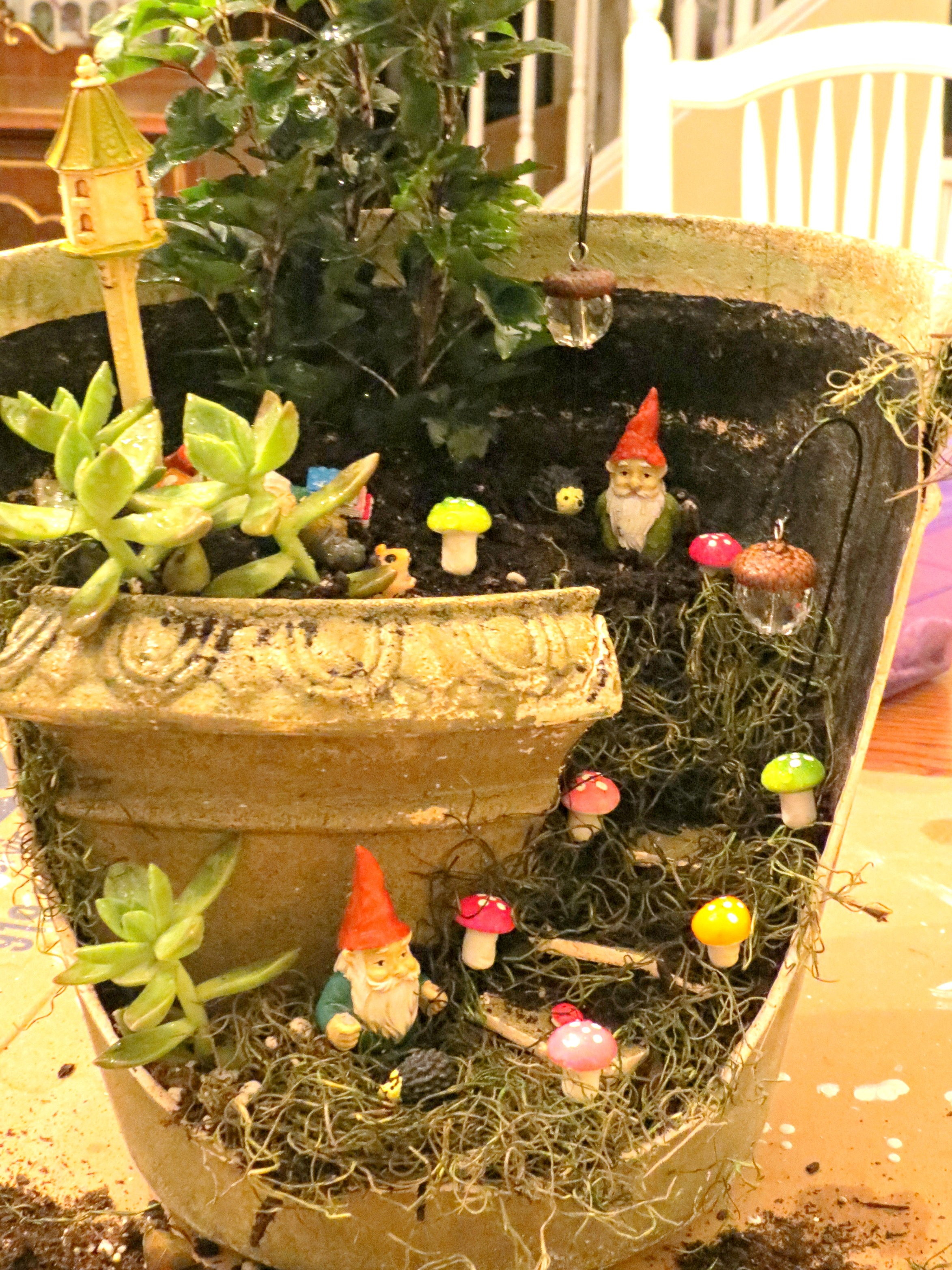 i think my favorite piece is the birdhouse theres a gnome sleeping at the foot of it he fell asleep while reading his book - Gnome Garden